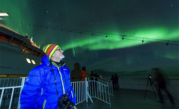 Passengers viewing the Northern Lights from the deck of a Hurtigruten cruise ship/