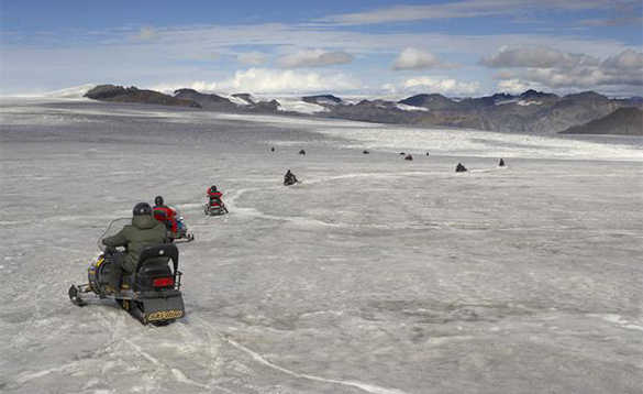 People enjoying snowmobiling in Iceland/