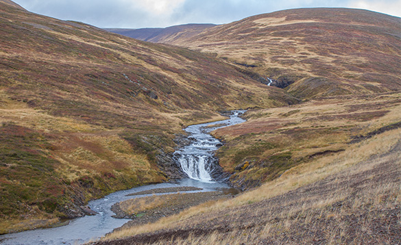 River flowing between hills in Iceland/