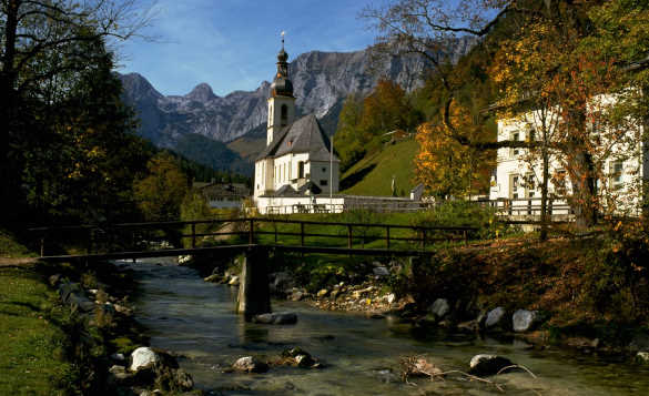 River flowing past a church in Ramsau located in the Bavarian Alps, Germany/