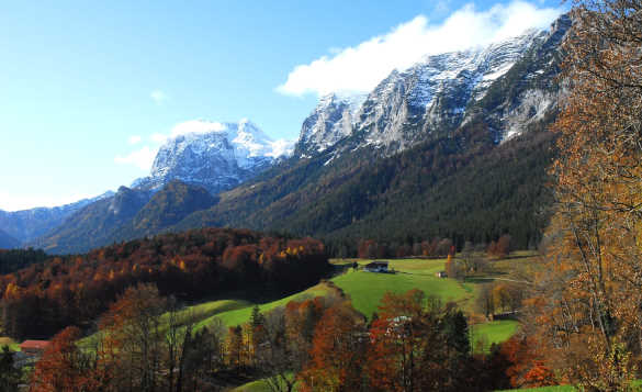Autumnal scene with snow capped mountains and autumnal trees in Berchtesgadener Land, Germany/