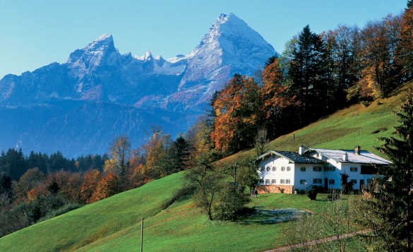 View across grassy hillside to the Watzmann massif in Berchtesgadener Land, Germany/
