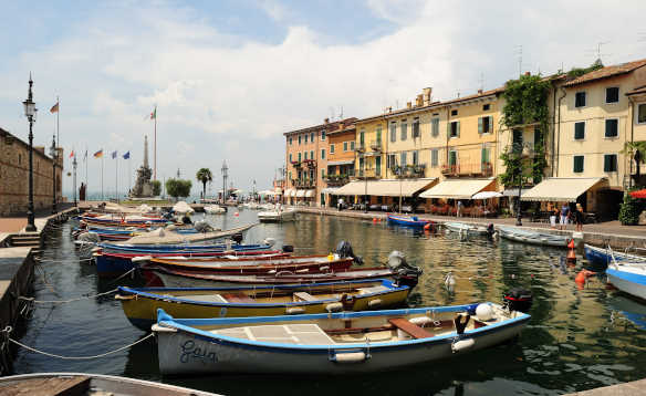 Boats moored in the marina in Lazise, Verona/