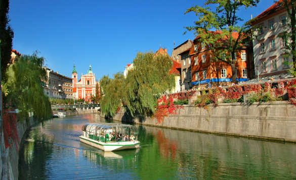 Sightseeing boat cruising along the River Ljubljanica through Slovenia's Capital city, Ljubljana/