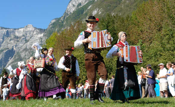 Slovenian people in traditional dress parading at the Cow Ball in Bohinj, Slovenia/
