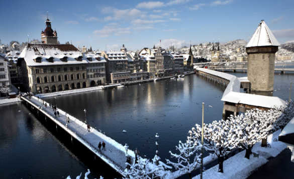 View across Lake Lucenre to the snow covered buildings of the Old Town in winter./