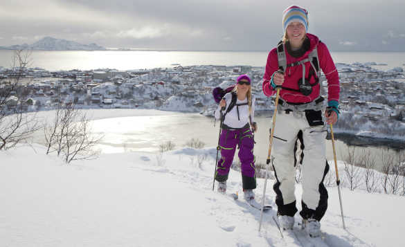 Couple cross country skiing in the Lofoten Islands, Norway/