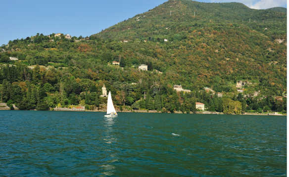 Yacht sailing across Lake Como in Cernobbio Italy/