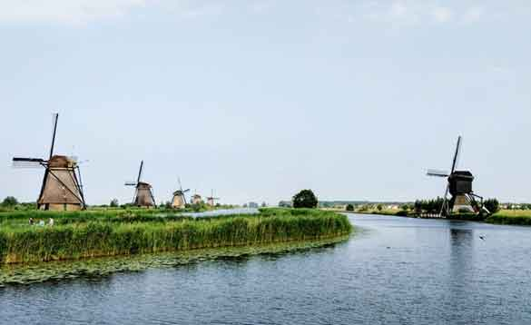 Windmills beside a canal in the Netherlands/