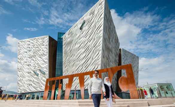 Two people outside the Titanic Belfast museum/