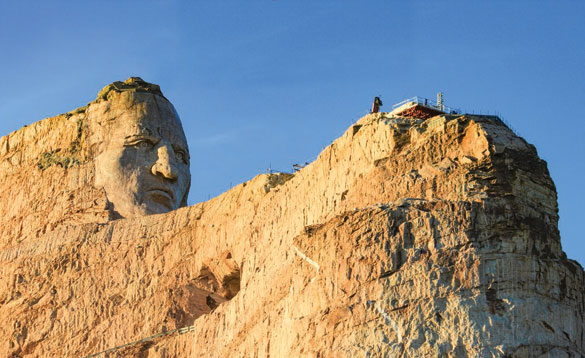 Rocky cliff with a large face cut into the side/