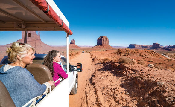 Tourists driving through Monument Valley in the USA/