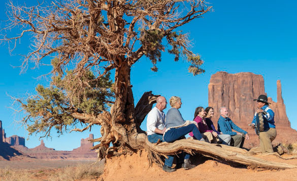 Tourists having a guided tour around Monument Valley in USA/