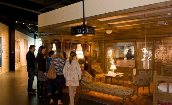Family looking at an exhibition in the Titanic Belfast museum/