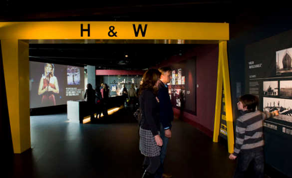 Family walking through the Titanic museum in Belfast/