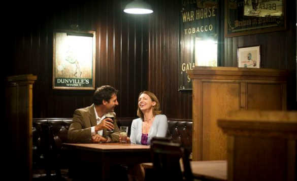 Couple enjoying a drink and chatting in the Garrick Bar Belfast/