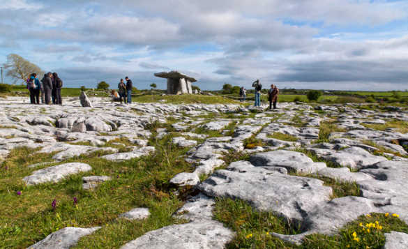 Tourists taking pictures of the Poulnabrone Dolmen in Co Clare, Ireland/