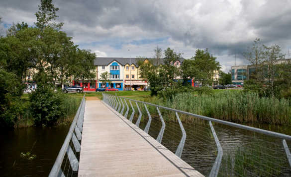 Wooden walkway across a river leading towards Carrick on Shannon, Co Leitrim/
