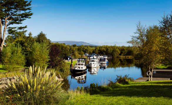 Boats moored along a canal in Co Leitrim/