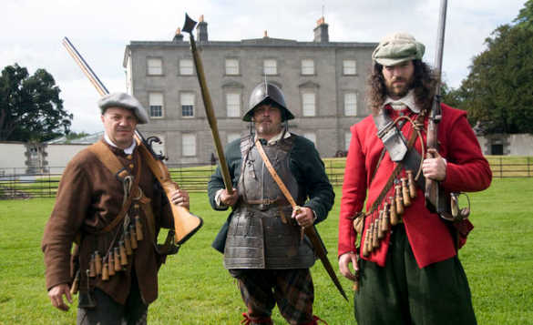 Three gentlemen dressed in authentic costumes at the Battle of the Boyne Visitor Centre/