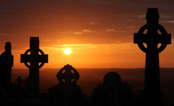 Sun rising over crosses on the Hill of Slane/