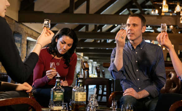 Group of people tasting whiskey at the Tullamore Dew Distillery/