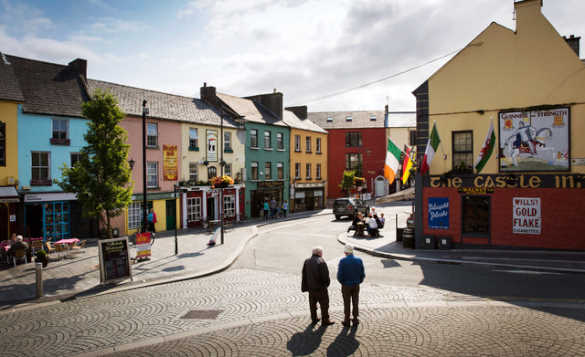 Brightly painted houses and shops along the main street in Athlone/