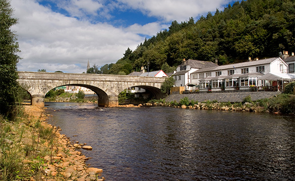 River flowing through an arched stone bridge in Avoca, Co Wicklow, Ireland/