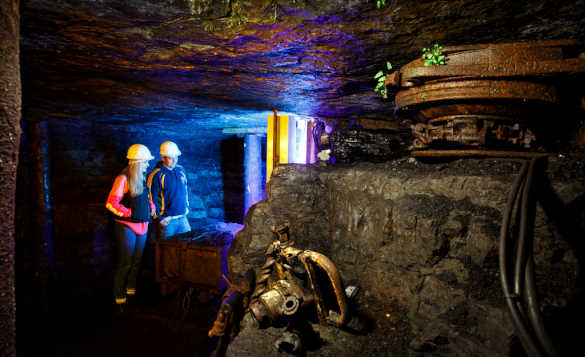 Couple in hard hats touring the Arigna Mines in Co Roscommon/