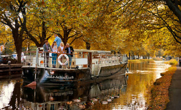 Tourists enjoying a boat trip along the Grand Canal, Dublin/