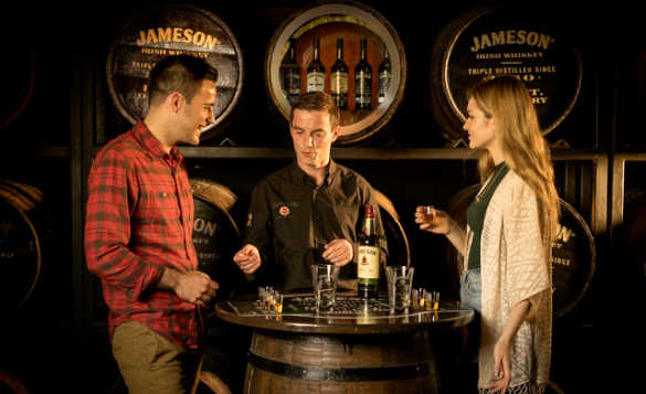 Couple tasting whiskey at the Jameson brewery in Dublin/