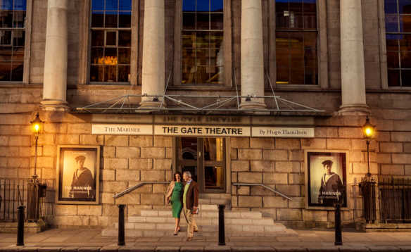 Couple walking down the steps at the entrance to the Gate Theatre in Dublin/
