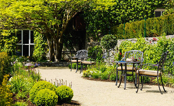 Wrought iron table and chairs on the garden terrace of Ballynahinch Castle, Connemara/