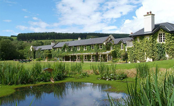 View across a pond and lawns to Brook Lodge Hotel in Wicklow/