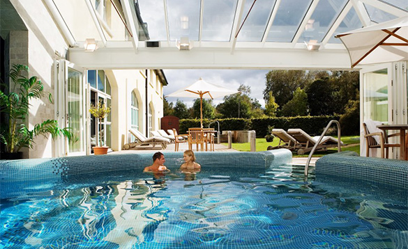 Couple chatting in a swimming pool at Brook Lodge Hotel, Wicklow/
