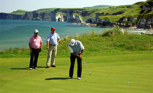 Golfers playing on Royal Portrush Golf Course/