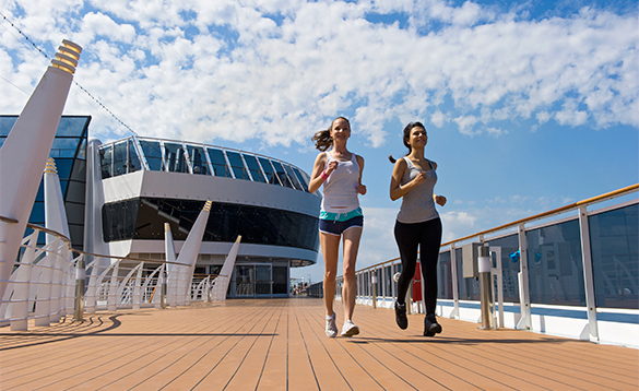 Two ladies jogging round the deck onboard the MSC Preziosa/