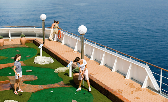 Couple of passengers enjoying a game of golf onboard MSC Musica/