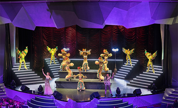 Passengers watching the singers and dancers on stage onboard MSC Preziosa/