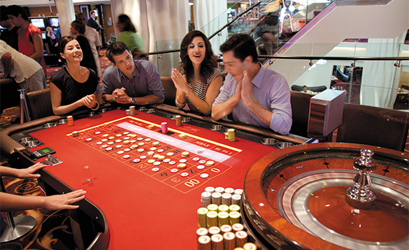 Passengers playing roulette in the casino onboard a NCL cruise ship/
