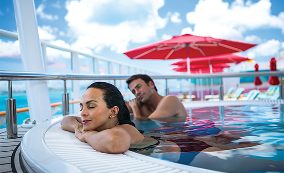 Couple relaxing in a jacuzzi onboard a NCL cruise ship/