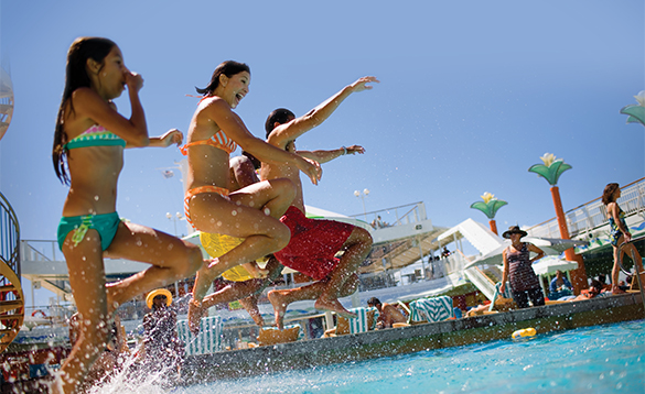 Group of children jumping into the pool onboard a NCL cruise ship/