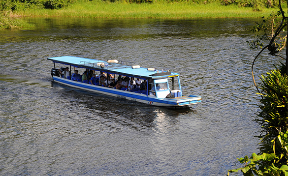 group of people taking a sight seeing boat trip along a river in Nicaragua/