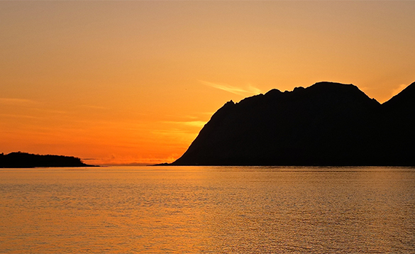 Sunsetting behind a mountain in Norway/