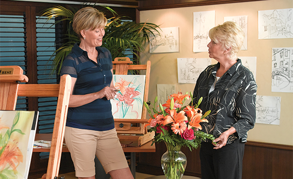 Ladies painting in an art class onboard an Oceania cruise ship/