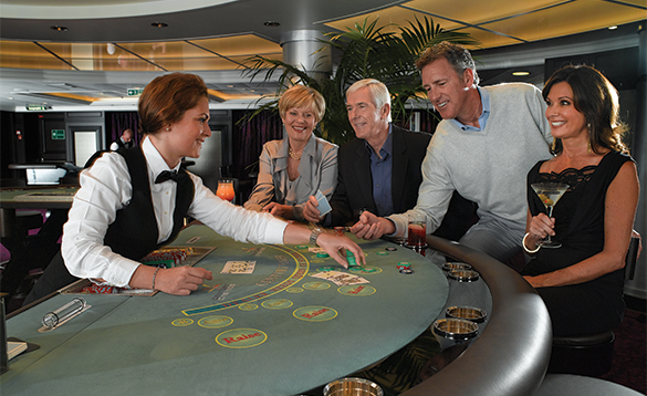 Two couples enjoying drinks in the casino onboard an Oceania cruise ship/