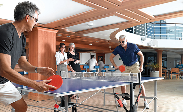 Two gentlemen playing table tennis onboard an Oceania cruise ship/