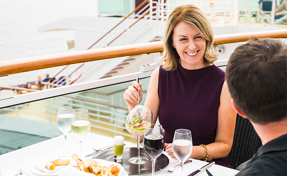 Couple dining in the Epicurean Restaurant onboard P&O Cruises Azura/