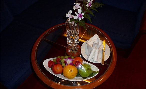 Table with dish of fruit/