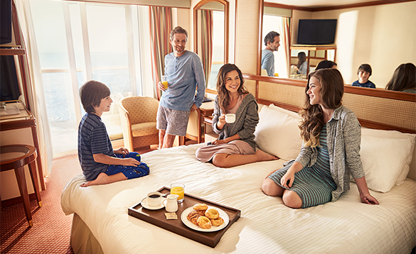 Group of people relaxing in a Stateroom cabin onboard a Princess cruises ship/